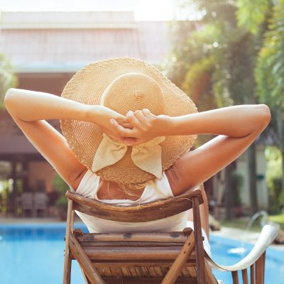 woman sunbathing with sunhat on