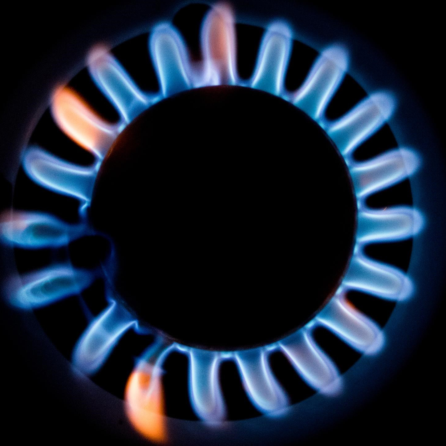 a gas hob being lit