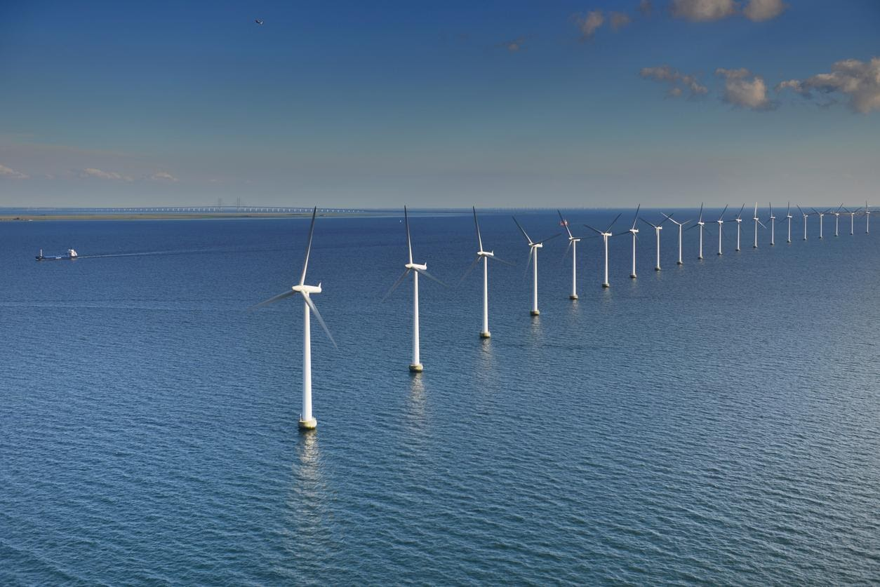 wind turbines making up part of an offshore wind farm.